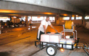 Chemical spray & pressure cleaning rig in parking garage