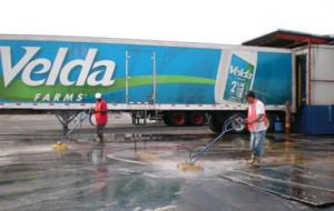 Scrubbing oily loading docks at Velda farms