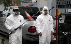 Technicians equipped with hazmat gear