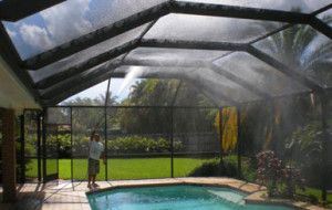 Rinsing the interior of a screened pool enclosure