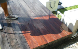 Wooden boat dock cleaned & treated with preservative oils