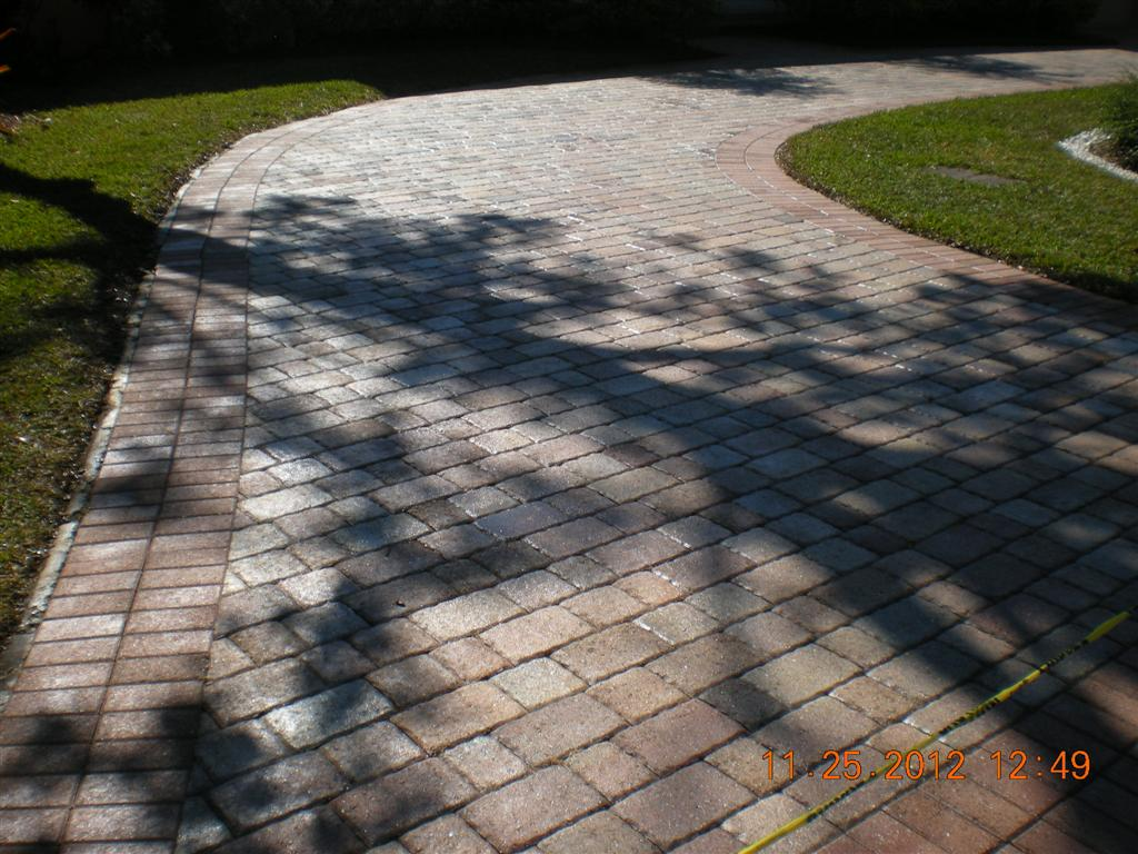 These pavers, view #11, after drying and the application of a satin acrylic sealer the driveway looks brand new!