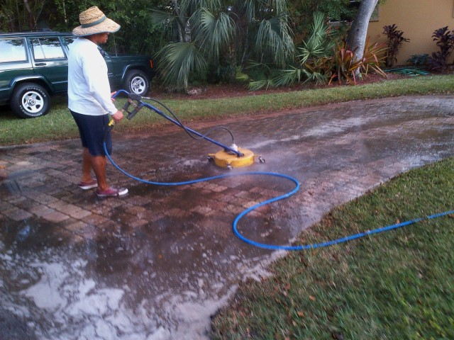 These pavers, view #3, are now being pressure washed with our rotary surface cleaner