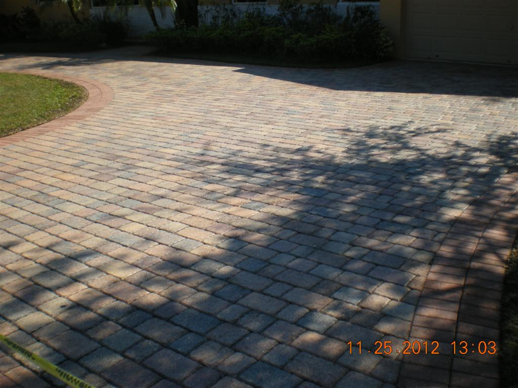 These pavers, view #9, after drying and the application of a satin acrylic sealer the driveway looks brand new!