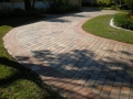 These pavers, view #10, after drying and the application of a satin acrylic sealer the driveway looks brand new!