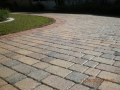These pavers, view #14, after drying and the application of a satin acrylic sealer the driveway looks brand new!