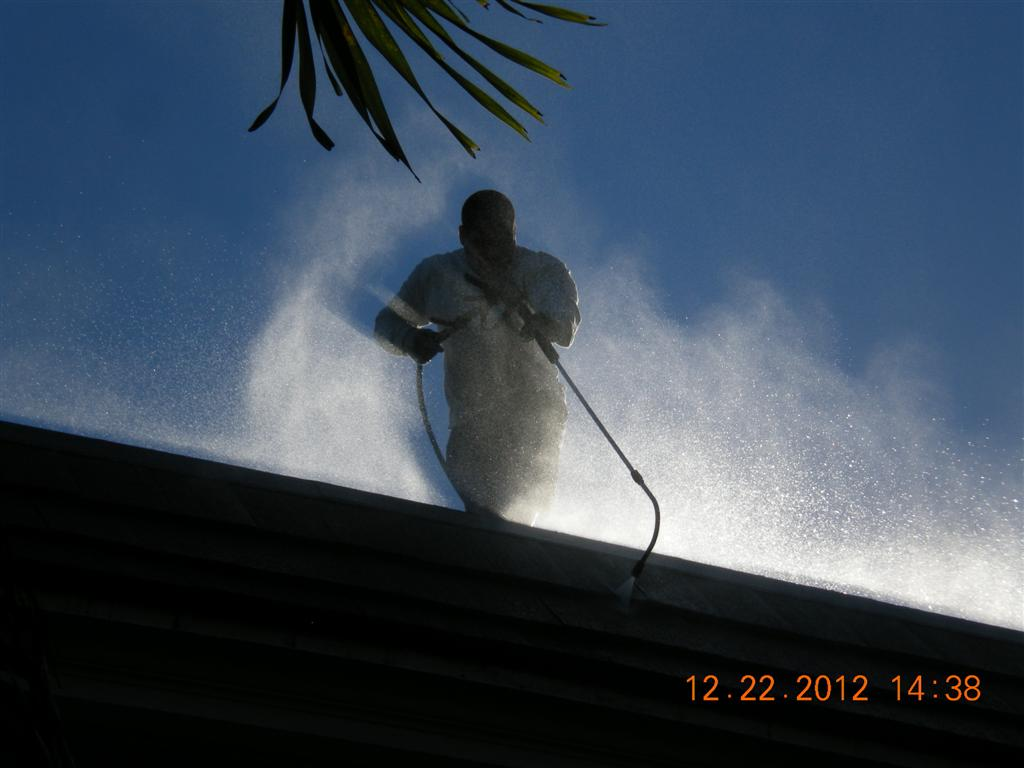 Who said cleaning roofs isn't just like snow skiing? One of our expert techs using one of many special accessories to clean this 2nd story mansard tile roof.
