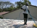 Using a low pressure rotary surface cleaner to gently clean your tile roof.