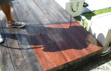 Pressure cleaning this teak deck carefully brings back the wood's rich color.